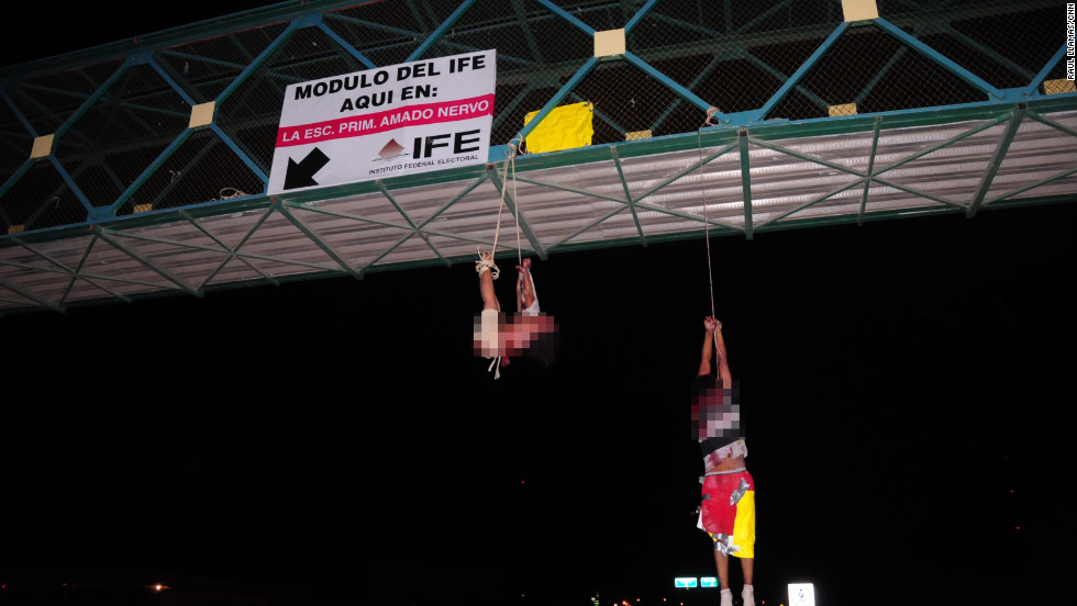 Two bodies hang from a bridge in Mexico in September 2011. Some cartels have developed reputations for sickening brutality -- seeming to kill for pleasure, just because they can.