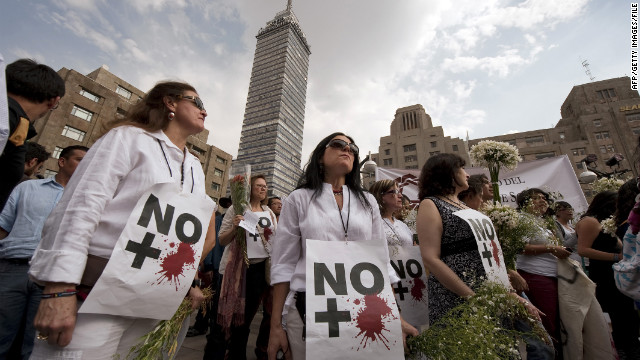 "Anti-violence activists protest in Mexico City in April 2011. Their signs read, ""No more blood."""