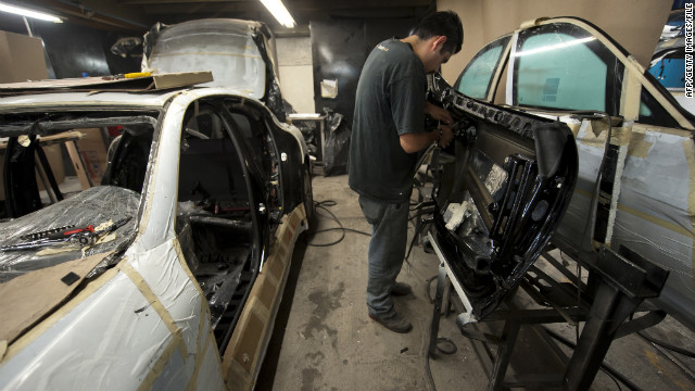 Armor plating is installed in a vehicle in Mexico City, where security businesses are booming.