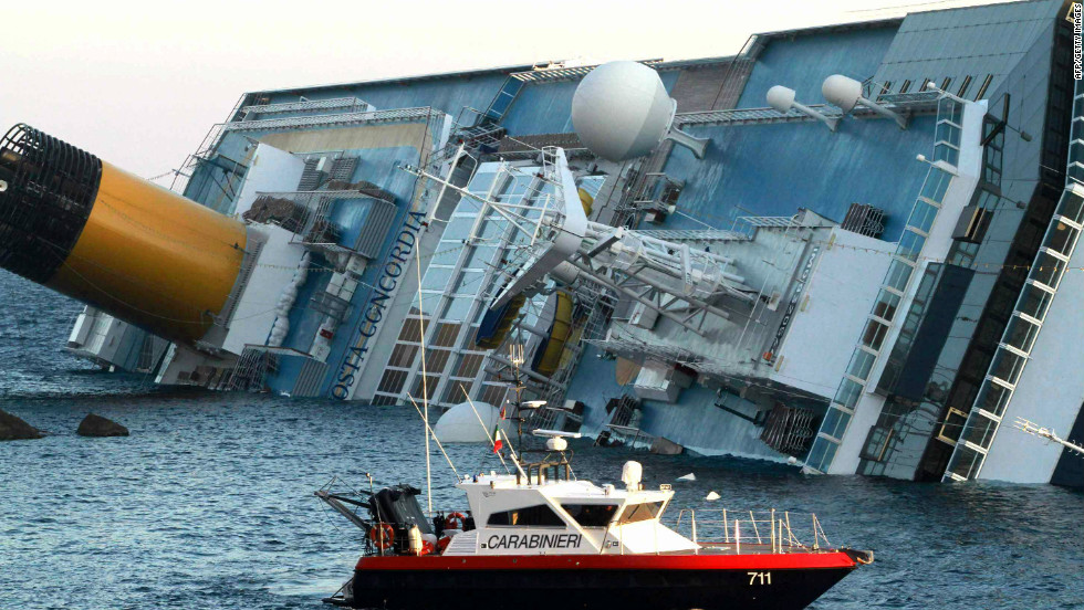 Italian police assist in the rescue after the cruise ship ran aground near the island.
