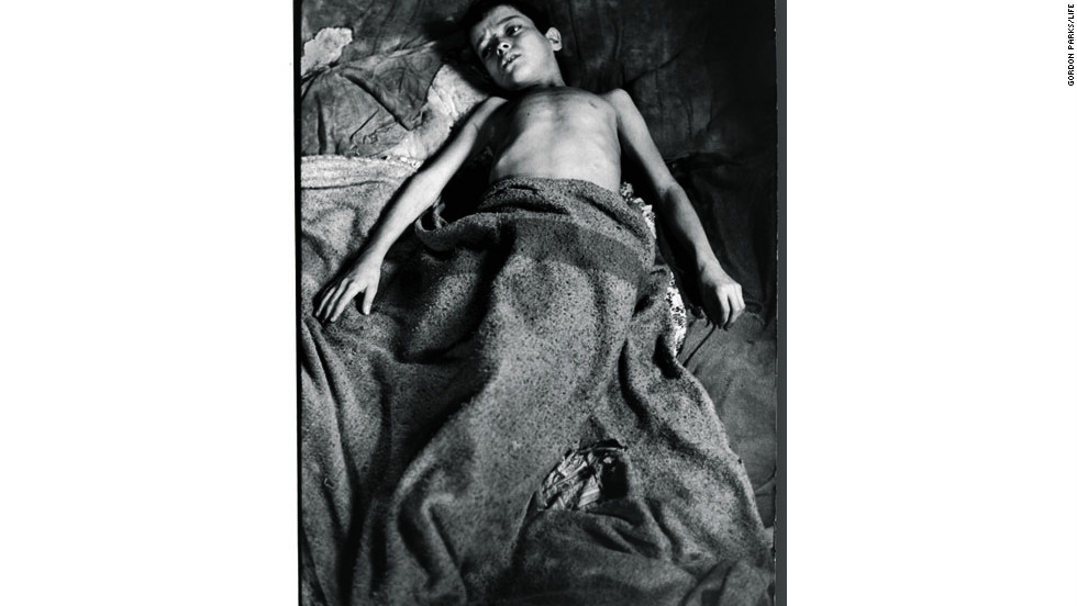 Twelve-year-old Flavio Da Silva in Rio de Janeiro is weary from caring for his brothers and sisters.