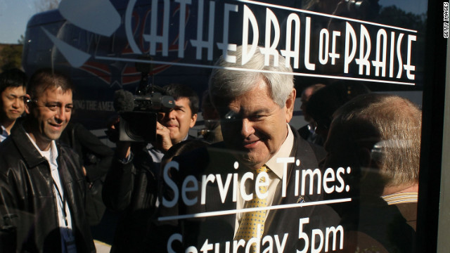 Republican presidential candidate Newt Gingrich arrives to speak during a campaign stop at the Cathedral of Praise Sunday in Charleston, South Carolina.