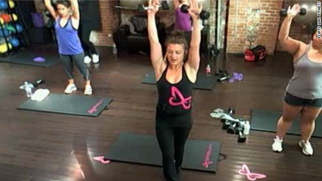 A Flirty Girl Fitness instructor teaches a class that's streaming live online to subscribers.