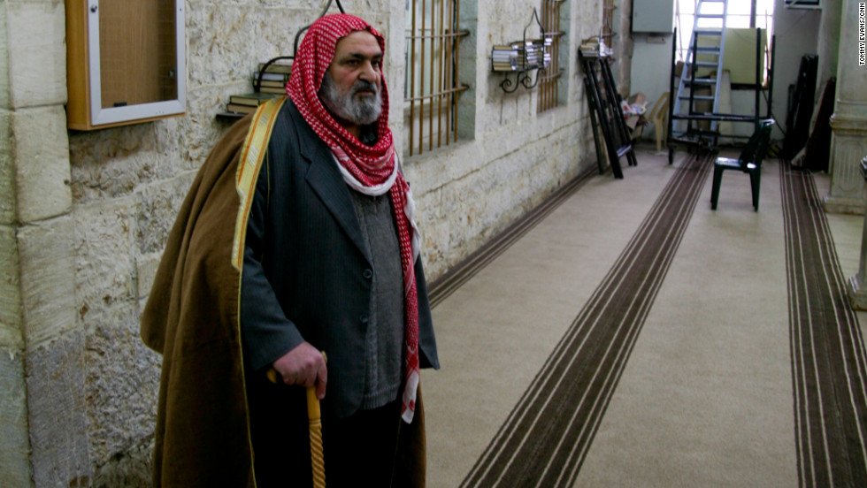 An elder waits in the mosque to speak to the monitors.