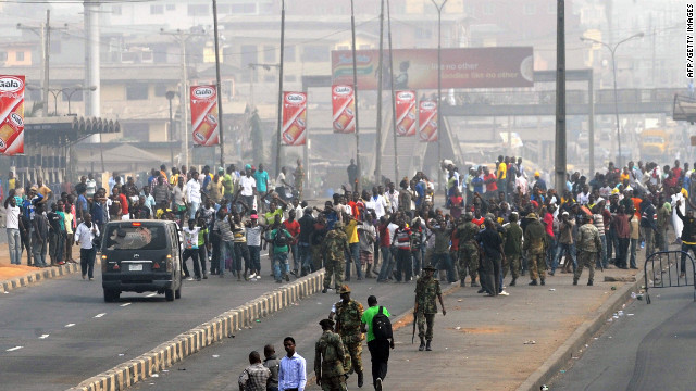 Soldiers march toward protesters after the government deployed troops to stop protests against rising oil prices in Nigeria.
