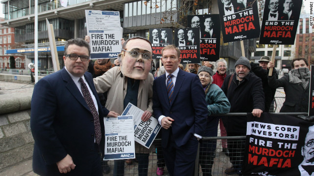 MP Chris Bryant (right) joins protesters calling for James Murdoch to stand down as chairman on November 29, 2011.