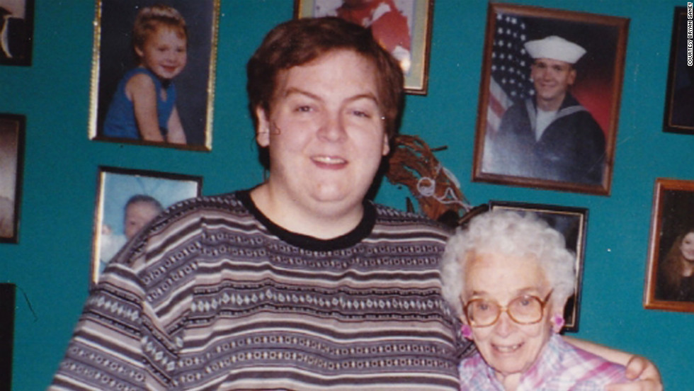 As a teenager Bryan weighed more than 400 pounds. He poses for a photo here with his grandma.