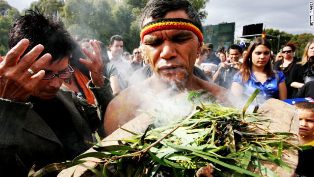 An Aboriginal man performs a smoke cleansing ceremony on the Parliament lawns, Canberra on February 13, 2008.