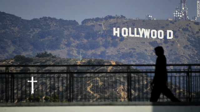"A walker passes in front of the iconic ""Hollywood"" sign in Los Angeles, where severed body parts were found this week."