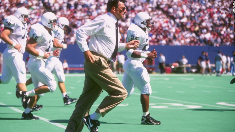 Paterno sprints off the field with his team at halftime in a 1996 game.