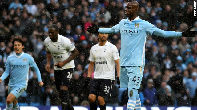 Manchester City's Mario Balotelli celebrates his winning penalty soon after he appeared to kick out at an opponent.