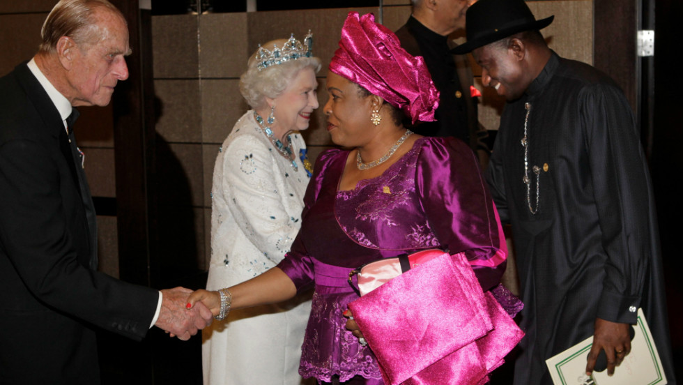 Britain's Queen Elizabeth II greets Nigerian President Goodluck Jonathan as his wife greets Prince Phillip at a banquet dinner in Perth on October 28, 2011