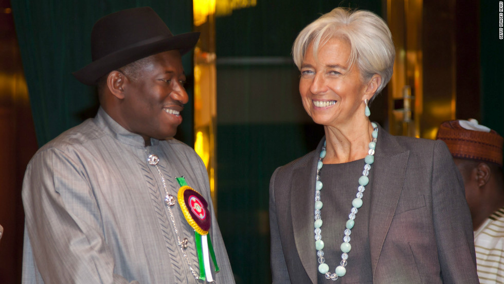 International Monetary Fund's Managing Director Christine Lagarde is greeted by President Jonathan on December 19, 2011. There is speculation her visit prompted the removal of fuel subsidy on New Year's day., which led to nationwide strikes and protests.