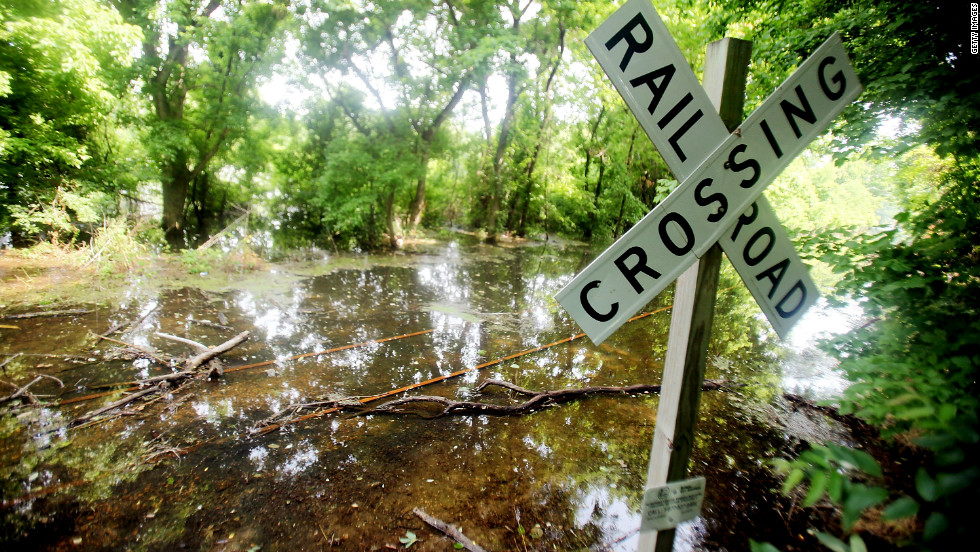 A railroad crossing is covered by floodwaters in Vicksburg, Mississippi, on May 23, 2011.