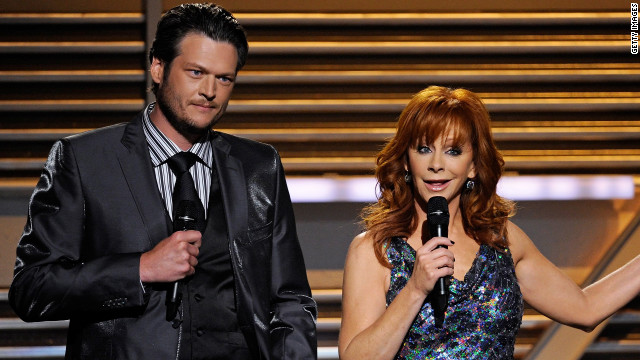 Blake Shelton and Reba McEntire, shown here hosting last year, will also host this year's Academy of Country Music Awards.