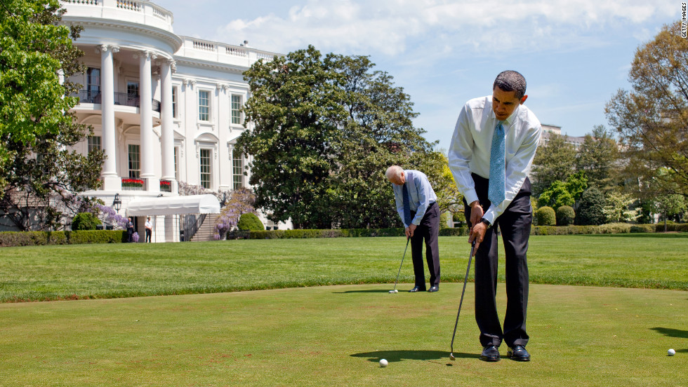 President Barack Obama and Vice President Joe Biden putt on the White House putting green in 2009.