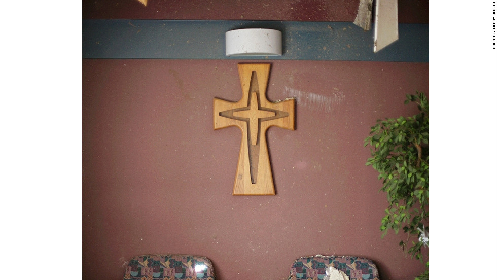 A 4-foot-tall wooden cross that hung on the emergency department waiting room wall at St. John's Mercy Hospital in Joplin, Missouri, will lead the way from the demolition site to the new hospital site on Sunday, January 29.