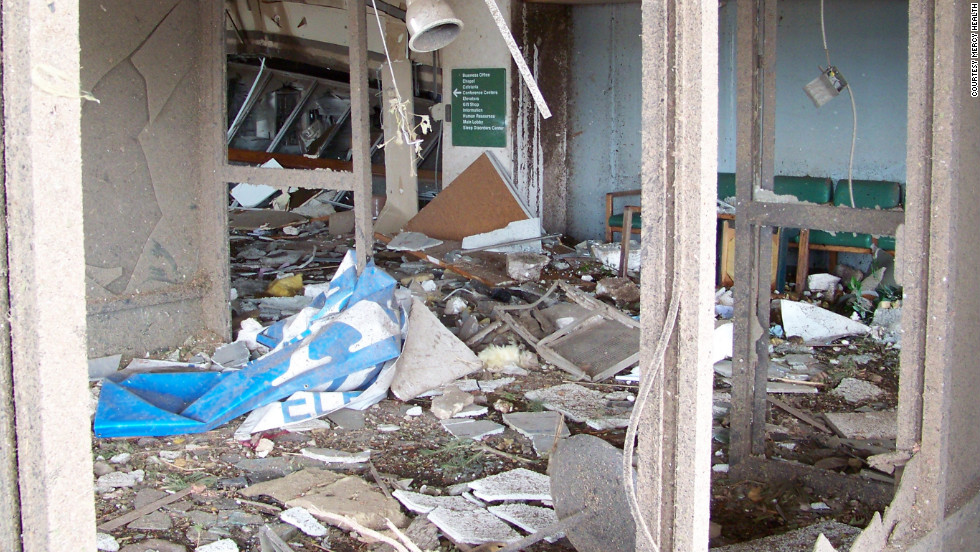 Debris litters the hospital after one of America's deadliest tornadoes hit the town in May. Workers have salvaged recyclable material, and the building is to be nearly empty when the demolition work begins.
