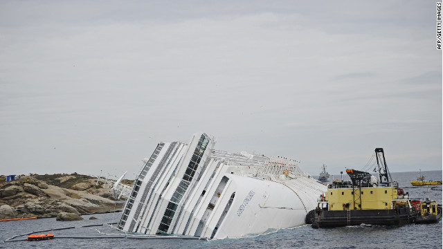 The wrecked ship Costa Concordia lies grounded in front of Giglio island.