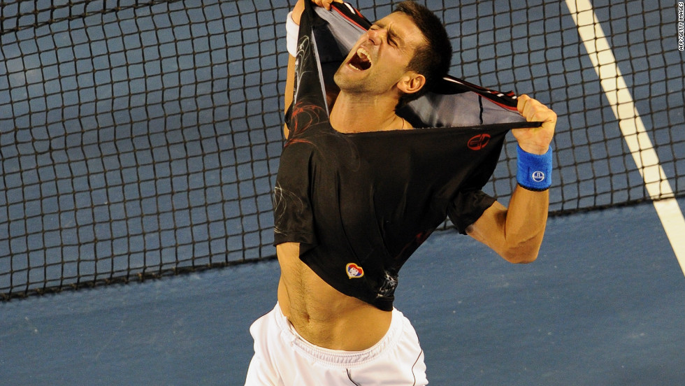 Novak Djokovic rips his shirt off as he celebrates his victory over Rafael Nadal at the Australian Open.
