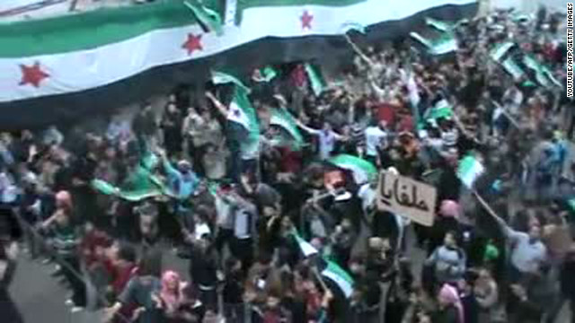 Syrian anti-regime protesters wave the country's pre-Baath flag during a demonstration in Helfaya on Sunday.