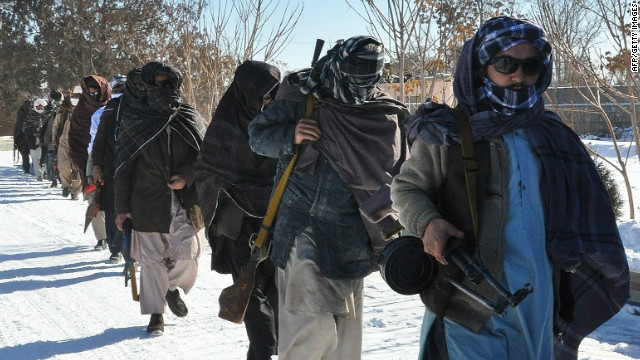 Taliban fighters are pictured after joining Afghan government forces for a ceremony in Ghazni province on January 16.