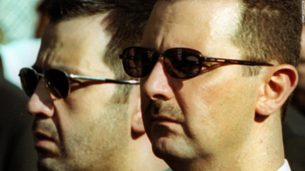 Syrian President Bashar al-Assad, right, and his brother Maher attend the funeral of their father in Damascus on June 13, 2000.