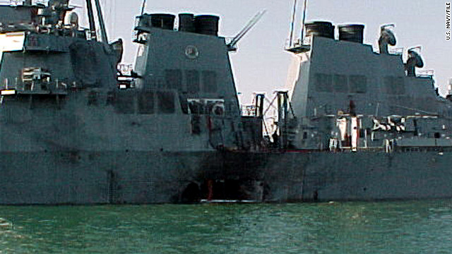 The USS Cole sits off the coast of Yemen after a terrorist attack blew a hole in its side. Seventeen U.S. sailors died in the 2000 attack.
