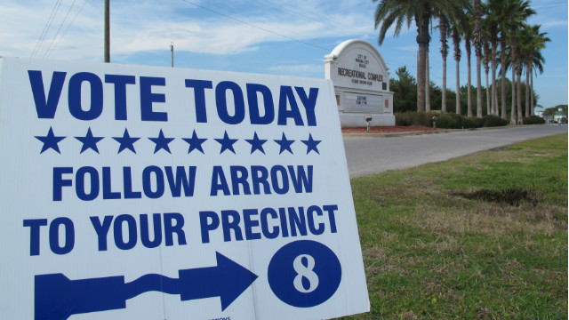 A sign guides voters to the polls in Panama City, Florida, on Tuesday. Fifty delegates are at stake in the GOP presidential primary.