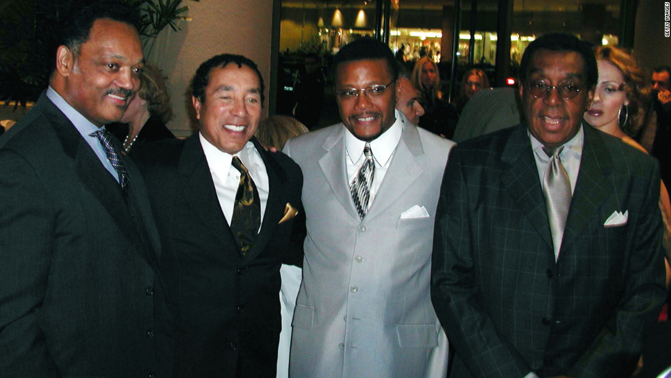 "Shown here with the Rev. Jesse Jackson, from left, singer Smokey Robinson and TV personality Judge Greg Mathis, the ""Soul Train"" creator attended an event in December 2001."