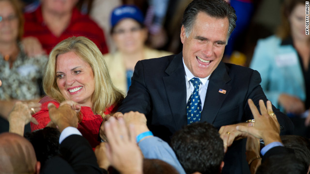 Florida primary winner Mitt Romney and his wife Ann greet supporters in the Tampa Convention Center.