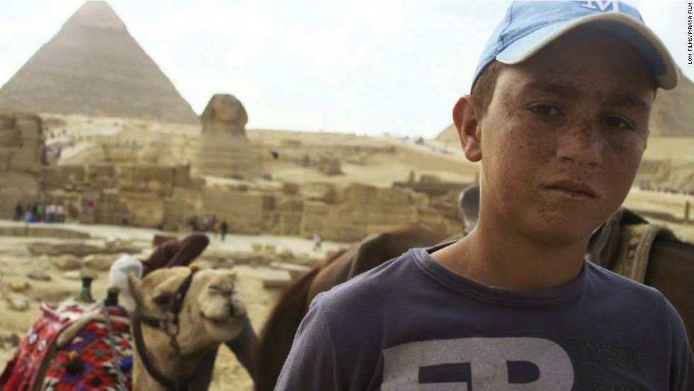 "Wally Hosni, 15, who works at the Pyramids giving horse rides to tourists, was thrust into the revolution when he was persuaded to join a group of men riding horses and camels into Tahrir Square on the infamous <a href=""http://edition.cnn.com/2011/WORLD/meast/02/02/egypt.protests.scene/index.html"">Day of the Camel</a>. He was almost killed as a result. His story is used in the film to illustrate the manipulation of the poor by those in power, says director Petr Lom."