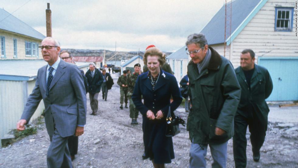 British Prime Minister Margaret Thatcher and her husband Denis, left,  visit Stanley Junior School, Stanley on the Falkland Islands in 1983.