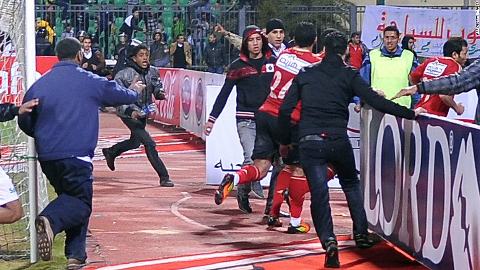 Al-Masry fans chase Al-Ahly players during riots that erupted after the football match.