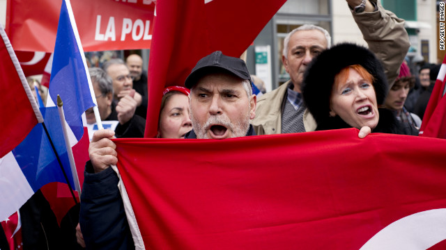 Turkish people demonstrate in France against a voting session for a bill criminalizing the denial of the Armenian genocide.