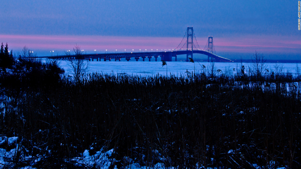 Mackinaw City, Michigan, was picked as its top tourist town. CNN iReporter John McGraw captured this winter sunrise at the Mackinac Bridge. Mackinaw City is at the bridge's south end.