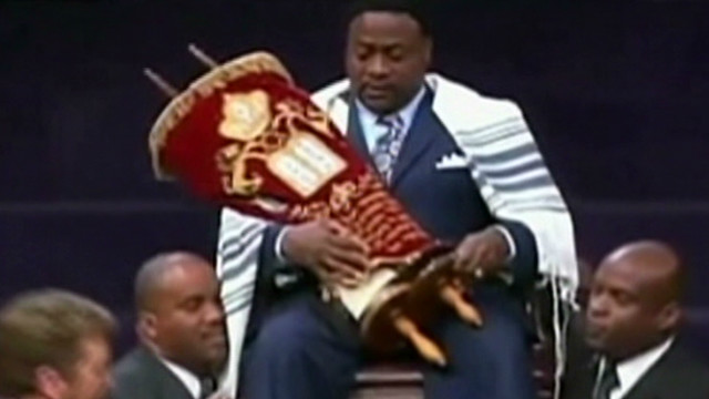 Bishop Eddie Long wrapped in a Torah