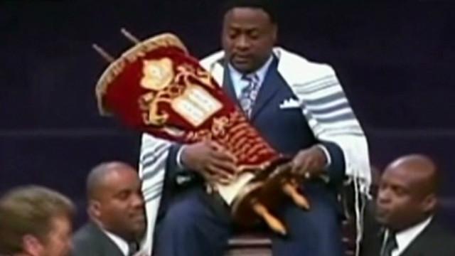 Bishop Eddie Long wrapped in a Torah