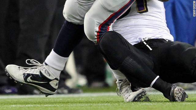Patriots' Rob Gronkowski's ankle twisted during this tackle in the January 22 AFC championship against the Baltimore Ravens.