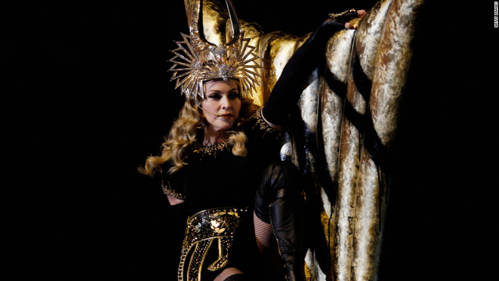 Madonna started her performance dressed as a Roman goddess clad in black and gold.