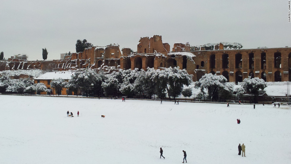 "iReporter John Pe shot this photo of the streets of Rome blanketed by heavy snowfall. He said local residents have ""gotten their snow gear and have taken to the slopes!"""
