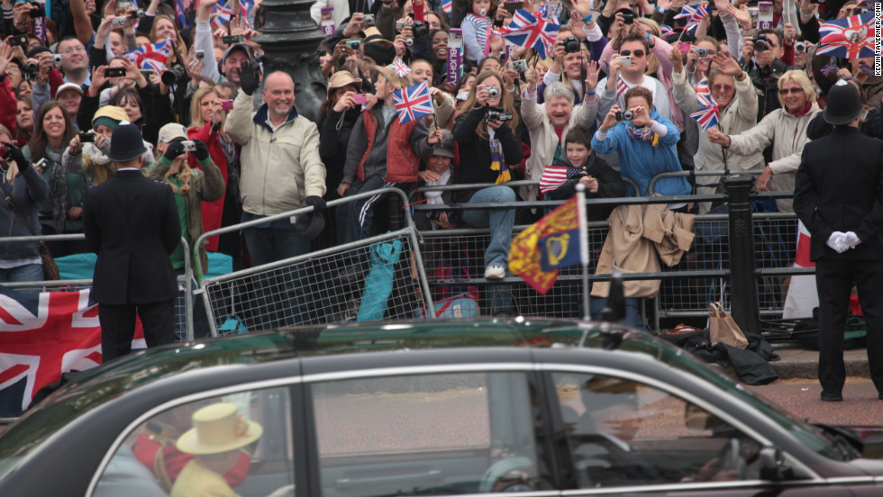 The Queen and Prince Philip drive past fans on the way to Westminster Abbey for the Wedding of William and Kate on April 29, 2011