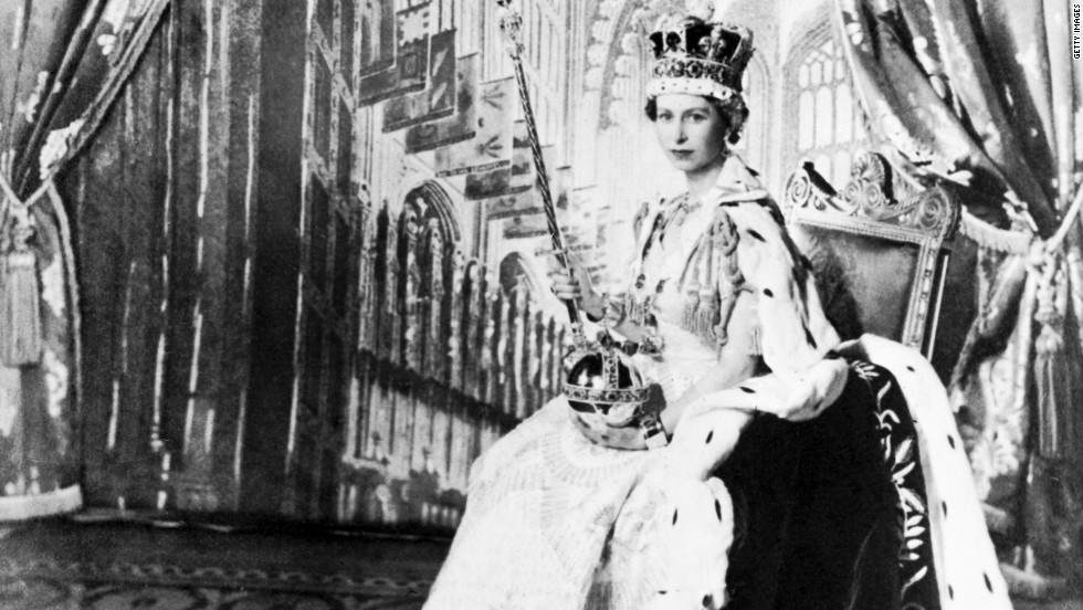 Queen Elizabeth II poses with the royal sceptre on June 2, 1953, after being crowned at Westminter Abbey in London.