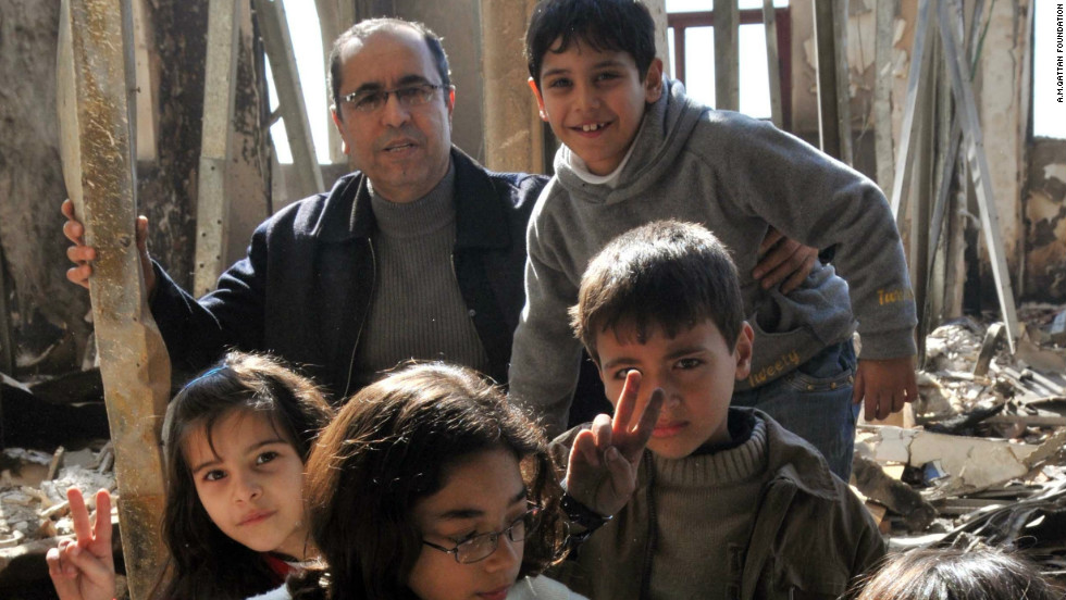 Academic Coordinator Ibrahim Najjar visits the ruins of the old school after it was destroyed in 2009.