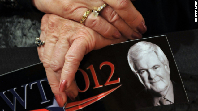 A Gingrich supporter attends a rally on the eve of Tuesday's voting in Missouri, Colorado and Minnesota.