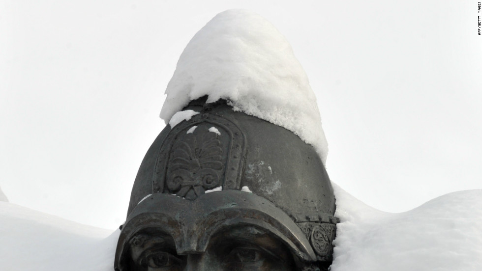 A monument is covered with snow in Kiev on February, 6, 2012 after heavy snowfalls in Ukraine. Ukraine on Monday blamed alcohol abuse as the main cause of deaths caused by a spell of abnormally cold weather that has claimed at least 135 lives over the last 10 days.