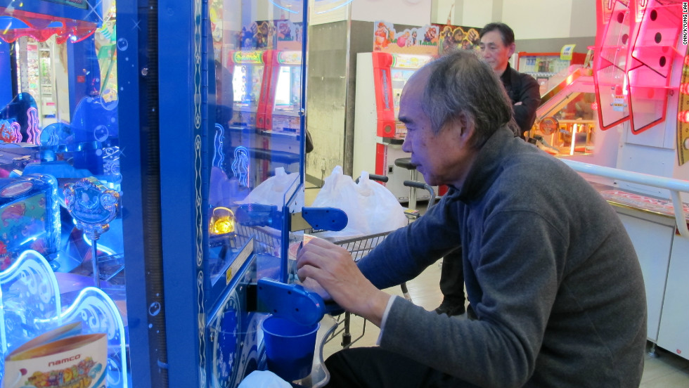 An older gamer plays at the arcade in Yokohama, Japan