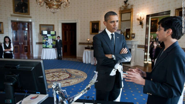 President Barack Obama meeting with a participant from the second annual White House Science Fair on February 7.