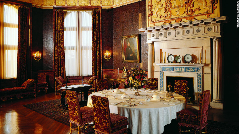 The home contains four acres of floor space and 250 rooms, including this breakfast room.