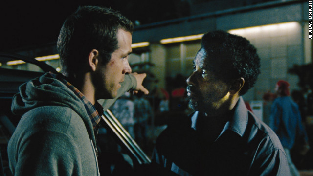 "Ryan Reynolds and Denzel Washington star in ""Safe House."""